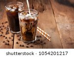 ice coffee in a tall glass with ... | Shutterstock . vector #1054201217