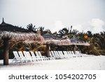 the row of empty plastic deck... | Shutterstock . vector #1054202705