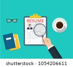 man holding resumes in hand.... | Shutterstock .eps vector #1054206611