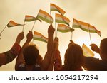 people holding small indian... | Shutterstock . vector #1054217294