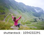 young woman with her hands up... | Shutterstock . vector #1054232291