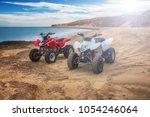quad atv all terrain vehicle ... | Shutterstock . vector #1054246064