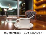 coffee and laptop laid out in... | Shutterstock . vector #1054264067