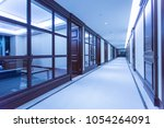 illuminated long corridor in...   Shutterstock . vector #1054264091