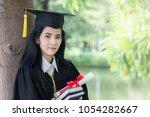 happy graduate young asian...   Shutterstock . vector #1054282667