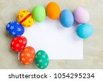 painted easter eggs put on the... | Shutterstock . vector #1054295234