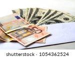 closeup of envelope full of... | Shutterstock . vector #1054362524