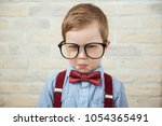 serious boy standing with in... | Shutterstock . vector #1054365491