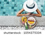 girl relaxing and eating fruit... | Shutterstock . vector #1054375334