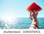 watermelon slice in woman hand... | Shutterstock . vector #1054376921