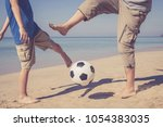 father and son playing football ... | Shutterstock . vector #1054383035