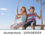 two happy little children in... | Shutterstock . vector #1054383059