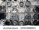 alloy wheels on racks in... | Shutterstock . vector #1054388801