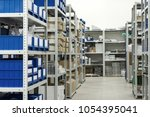 warehouse of components for the ... | Shutterstock . vector #1054395041