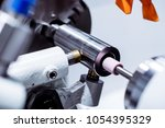 intragrinding machine during... | Shutterstock . vector #1054395329