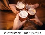 friends clinking and toasting...   Shutterstock . vector #1054397915