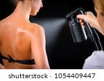 woman body paint with airbrush... | Shutterstock . vector #1054409447