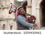 Small photo of Jerash, Jordan - October 24, 2018: Military bagpipe player perform for tourists at the South Theatre in Gerasa, Jerash