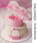 pink cake with crown and gifts... | Shutterstock . vector #1054417544