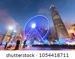 ferris wheel in hong kong city... | Shutterstock . vector #1054418711