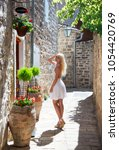 cute blonde tourist woman in... | Shutterstock . vector #1054420769