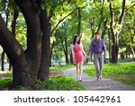 couple walking in the park | Shutterstock . vector #105442961