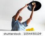 woman changing lightbulb   Shutterstock . vector #1054450109