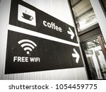 coffee and free wifi sign in... | Shutterstock . vector #1054459775