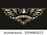 black eagle symbol  emblem on a ... | Shutterstock .eps vector #1054481015