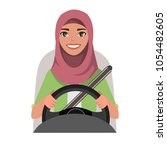 muslim woman driving a car.... | Shutterstock .eps vector #1054482605