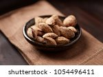 salt roasted almonds with shell ...   Shutterstock . vector #1054496411