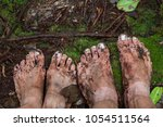 Dirty Feet On Moss In Jungle....
