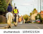 Two Horse Riders Travel Throug...
