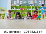 group of diversity kid lay down ... | Shutterstock . vector #1054521569