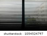 dark venetian blinds ominously...   Shutterstock . vector #1054524797