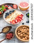 superfood smoothie bowl on old... | Shutterstock . vector #1054530707