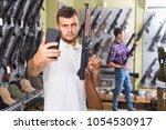male is taking selfie on phone... | Shutterstock . vector #1054530917