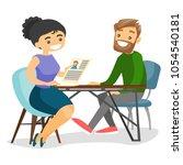 two businesswomen talking on...   Shutterstock .eps vector #1054540181