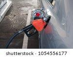 pumping gasoline fuel in car at ... | Shutterstock . vector #1054556177