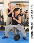 coach instructing young man... | Shutterstock . vector #105455771