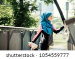 muslim woman hijab exercise... | Shutterstock . vector #1054559777