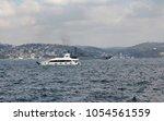 yacht and war ship cross...   Shutterstock . vector #1054561559