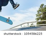 skater jumps high in air on... | Shutterstock . vector #1054586225