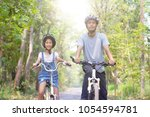 happy father and daughter... | Shutterstock . vector #1054594781
