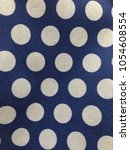 textile pois texture in a blue... | Shutterstock . vector #1054608554