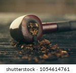 pipe smoking tobacco close up... | Shutterstock . vector #1054614761