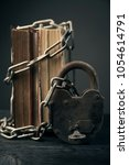 old book chain lock concept... | Shutterstock . vector #1054614791