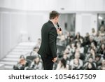 successful businessman holds... | Shutterstock . vector #1054617509
