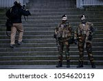 Small photo of Belgian soldiers stand guard at the entrance to the courthouse in Brussels, Belgium on Feb 5 2018 for the second day of the trial of prime suspect in the November 2015 Paris attacks Salah Abdeslam