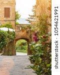 colorful street in pienza ... | Shutterstock . vector #1054621991